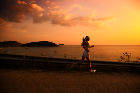 http://www.dreamstime.com/royalty-free-stock-images-young-woman-running-sunset-image29317699