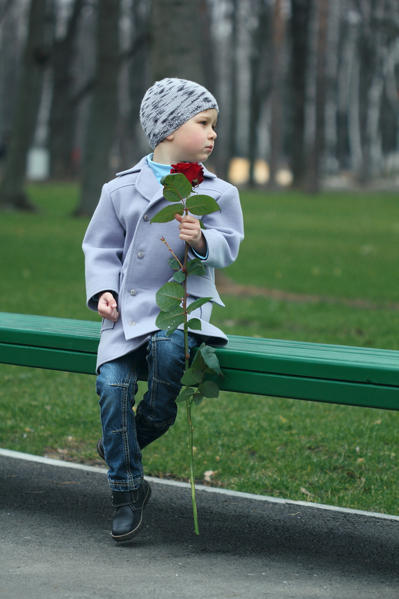 Little boy waiting in the park