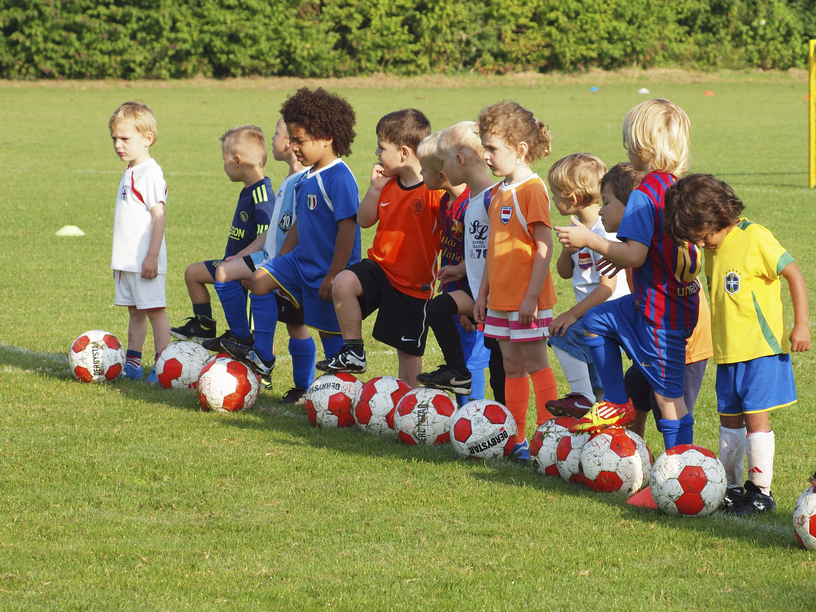 small children at football training