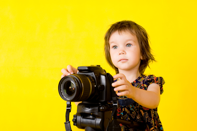 http://www.dreamstime.com/stock-photography-baby-girl-holding-photo-camera-image9988812